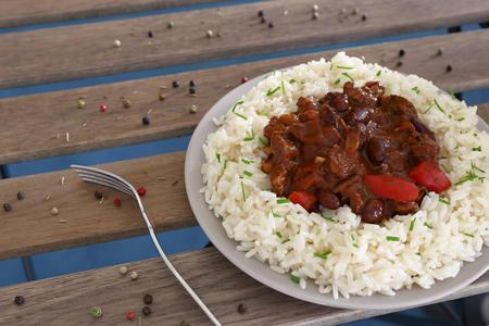 tex mex: chilli con carne with rice on plate with fork