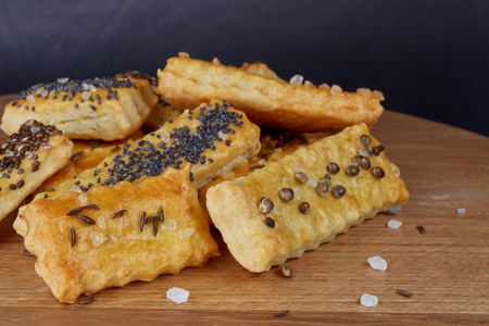 Baked puffy cheese sticks with caraway seeds, poppy seeds, chia seeds and salt