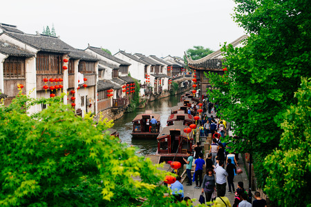 Crowded tourist destination near a canal in an ancient town