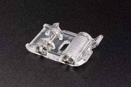 Roller foot sewing machine part Banque d'images