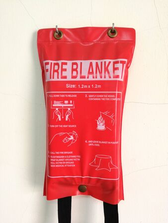 Wall mounted fire blanket in physics laboratory at elementary school