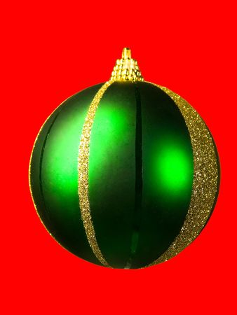 Christmas green red ball isolated on a red background.