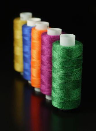 needlewoman: Sewing thread.
