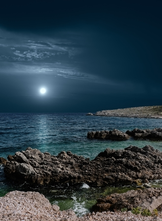shorelines: The moon over the sea Stock Photo