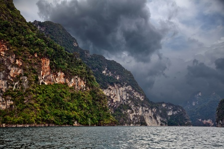 Storm clouds over the mountains and lake Stock Photo - 13783683