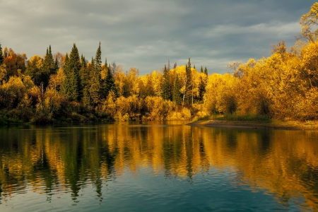 Autumn Sunset in the wild Siberian taiga photo