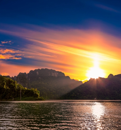 Sunset over the lake Cheo Lan in Thailand photo