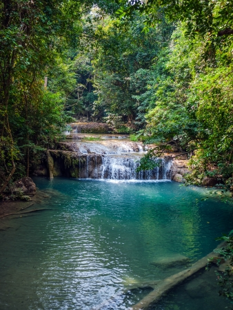 Waterfall in the rainforest. Erawan National Park in Thailand. photo