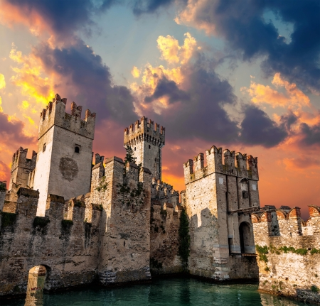 sirmione: Medieval Castle Scaliger at sunset Editorial