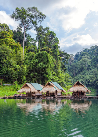 Floating village on Lake Cheo lan in Thailand photo