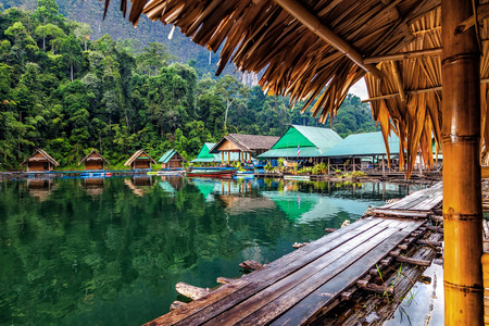 palmy: Floating village on Lake Cheo lan in Thailand Editorial