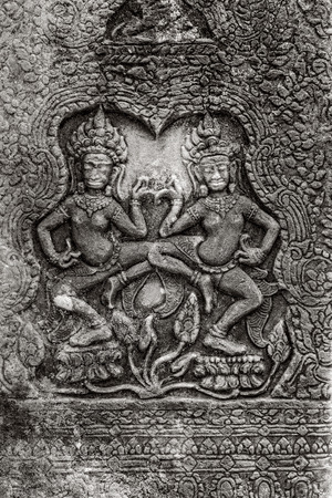 murals: Apsara Dance  Bas-relief on the walls of the ancient Khmer temple of Angkor Thom