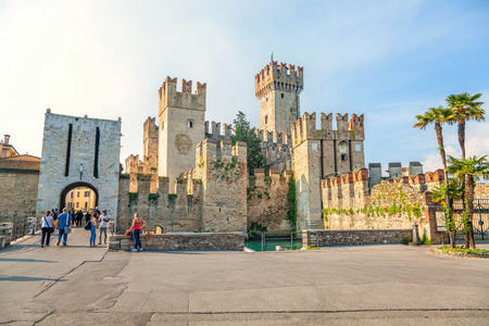 sirmione: Sirmione, Italy - JUNE 07, 2013: The Italian town of Sirmione. At the center of the frame - famous castle of Scaliger.