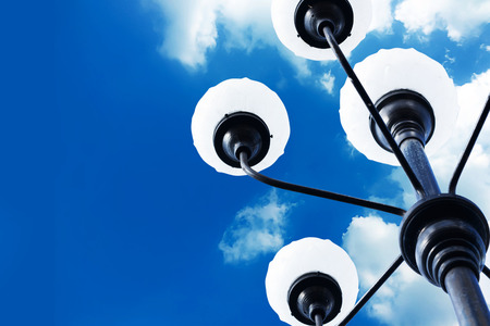electric avenue: Street light on the blue sky with the fluffy clouds background
