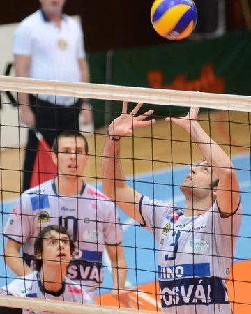 KAPOSVAR, HUNGARY - DECEMBER 8: Jozsef Nagy (R) posts the ball at the Challenge Cup volleyball game Kaposvar (HUN) vs Prefaxis Menen (BEF). Stock Photo - 8449262