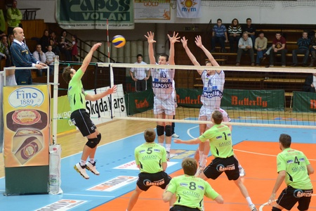 KAPOSVAR, HUNGARY - DECEMBER 8: Tamas Kaszap (10) blocks the ball at the Challenge Cup volleyball game Kaposvar (HUN) vs Prefaxis Menen (BEF) Stock Photo - 8449269
