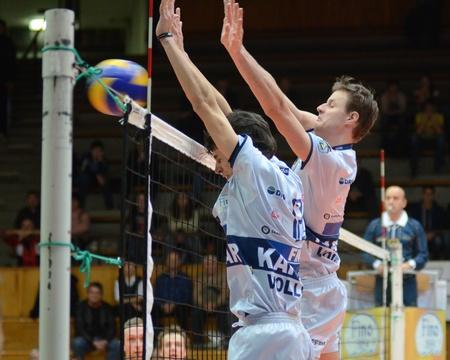 KAPOSVAR, HUNGARY - DECEMBER 8: Balazs Bagics (L) blocks the ball at the Challenge Cup volleyball game Kaposvar (HUN) vs Prefaxis Menen (BEF). Stock Photo - 8449267