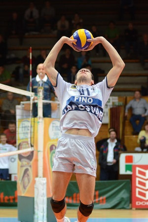 KAPOSVAR, HUNGARY - DECEMBER 8: Tamas Kaszap posts the ball at the Challenge Cup volleyball game Kaposvar (HUN) vs Prefaxis Menen (BEF) Stock Photo - 8449270
