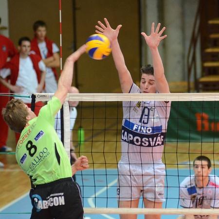 KAPOSVAR, HUNGARY - DECEMBER 8: Istvan Schulcz (13) blocks the ball at the Challenge Cup volleyball game Kaposvar (HUN) vs Prefaxis Menen (BEF) Stock Photo - 8449265