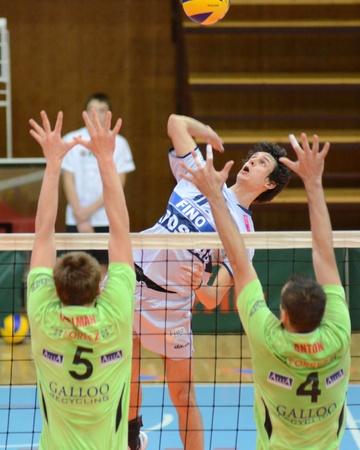 KAPOSVAR, HUNGARY - DECEMBER 8: Balazs Bagics (C) strikes the ball at the Challenge Cup volleyball game Kaposvar (HUN) vs Prefaxis Menen (BEF). Stock Photo - 8449263