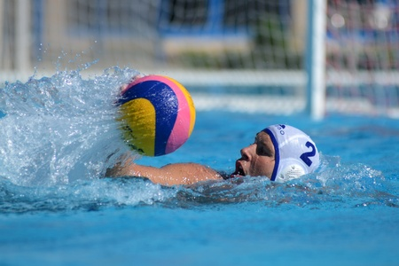 vigor: KAPOSVAR, HUNGARY - OCTOBER 1: Robert Maar (white 2) in action at a Hungarian national championship water-polo game Kaposvar (white) vs. Honved (green) on October 1, 2011 in Kaposvar, Hungary