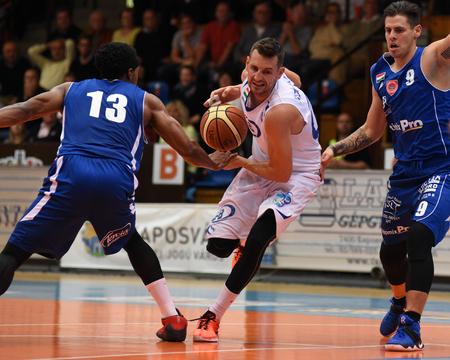 Kaposvár, HUNGARY - OCTOBER 6: Marton Fodor (white 8) in action at Hungarian Championship basketball game with Kaposvar (white) vs. Sopron (blue) on October 6, 2016 in Kaposvar, Hungary.