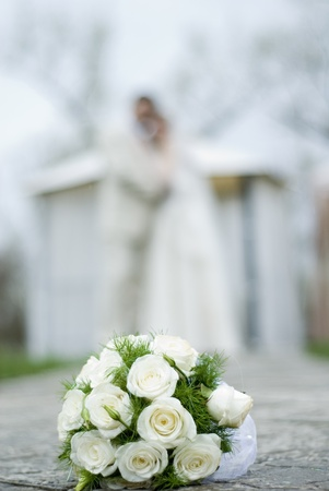 affiance: A Wedding couple with a Bridal bouquet