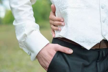 cuff link: the mans hand adjusts shirt Stock Photo