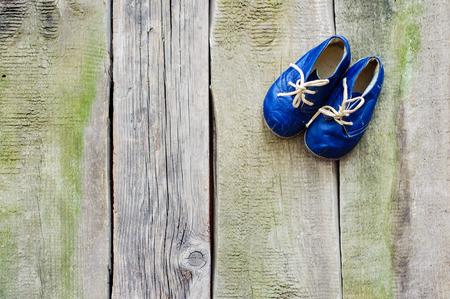 antique sleigh: Vintage boot on wood, retro background. Stock Photo