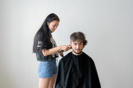 hairstyling: Mens hairstyling and haircutting in a barber shop or hair salon.