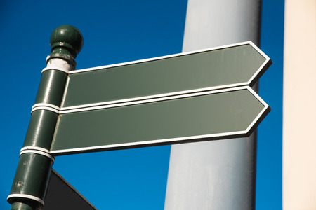 irish cities: Two irish signposts with blue sky and copyspace