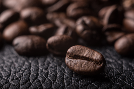 makro: Coffee beans on the leather surface, makro pgotography, cafe concept