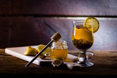 flue: Natural medicones against flue and cold. Honey, lemon, hot tea, onion and garlic. Health concept.