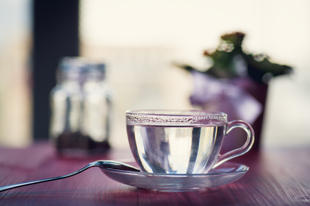 Glass cup full of hot water ready to dring or prepare tea