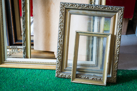 Old wooden painting frames in painter studio