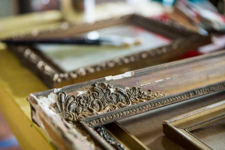 Old wooden painting frames in painter studio Zdjęcie Seryjne - 78844212