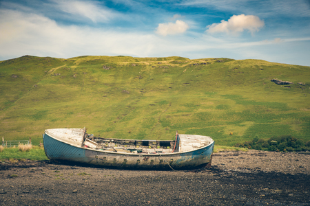 great bay: Old wreck fishing boat lying on the dry bottom of the sea during outflow Stock Photo