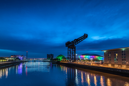 The Clyde Auditorium, Hydro Arena and Finnieston crane on the banks of the river Clyde as seen from the Clyde Arc Bridge.