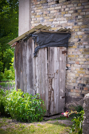 Old wooden toilet outside the house Stock Photo