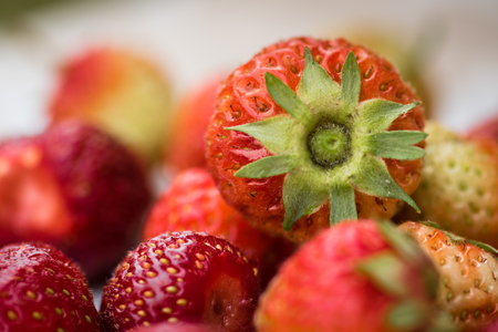 Close-up view of group of fresh strawberries. Natural. No preservatives.