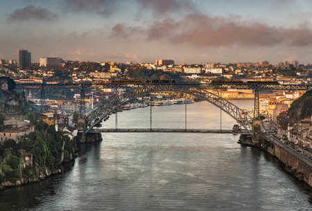 View at Ponte Luis I bridge in Porto in the morning golden hour