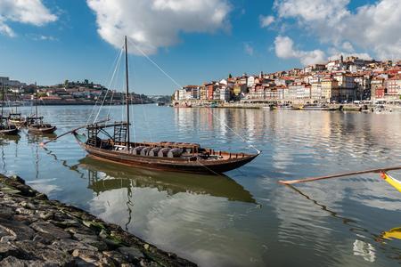 Port wine storage warehouses and transport boats at river Duoro in Vila Nova de Gaia opposite Porto, Portugal