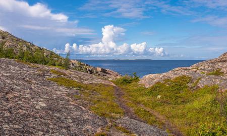 View of rocks of the archipelago of Kuzova,sea, blue sky, clouds. photo