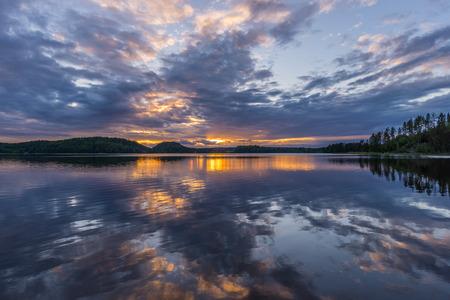 ladoga: Orange sunset on Lake Ladoga. Reflection. Karelia, Russia. Stock Photo