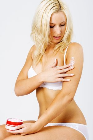 massacre: Gorgeous blond applying lotion and makeup