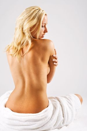 hand towel: Blonde girl with bare back after shower
