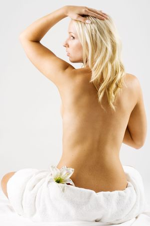 Blond girl with bare back after shower Stock Photo - 2308952