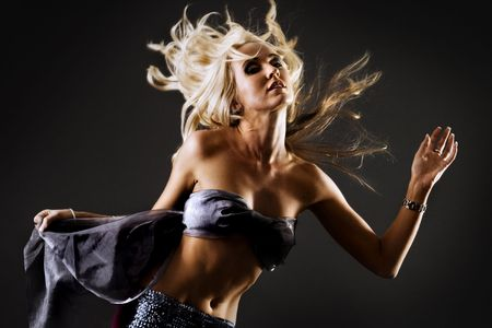 flying hair: Beautiful blond female with flying hair dancing Stock Photo