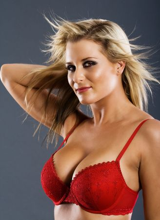 Portrait of attractive woman in red bra photo