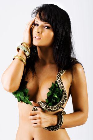 Sexy woman in green bikini with a snake Stock Photo